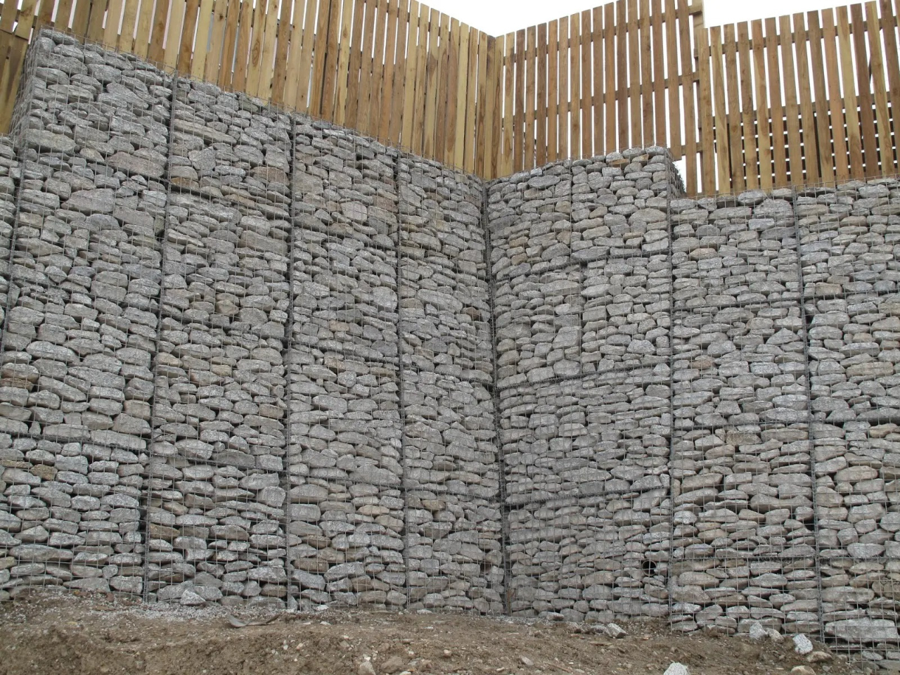 Stone wall with wooden fence (close up)
