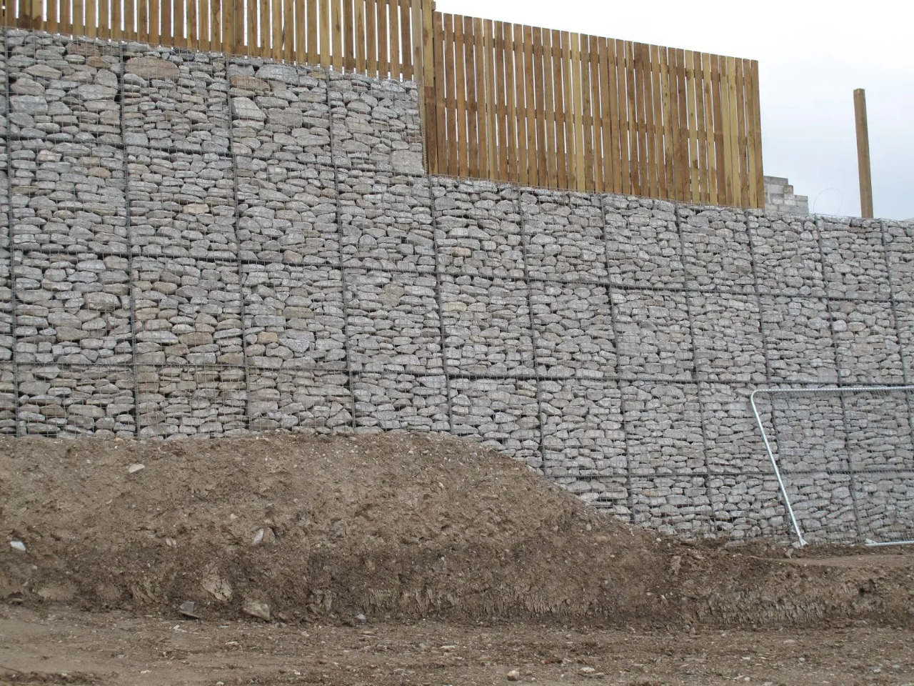 Stone wall with wooden fence